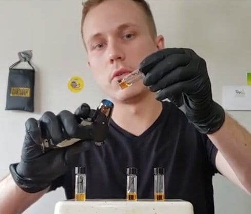 applying heat gun to vial