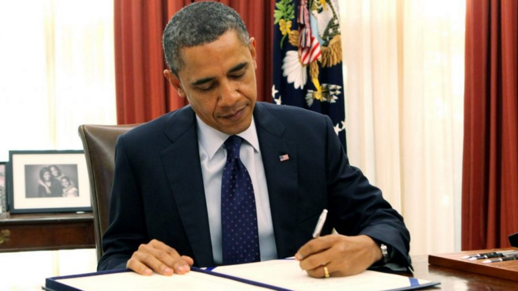 Obama_signing_bill